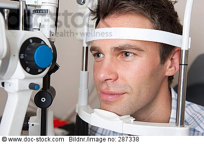 Close up of man undergoing eye examination