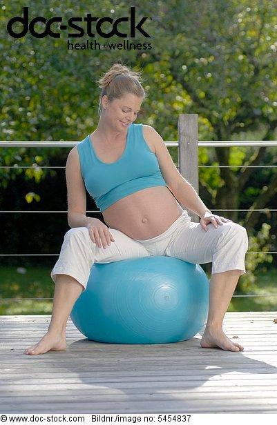 Pregnant woman doing gymnastics