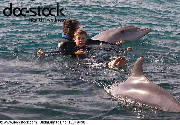 dolphin therapy with handicapped child