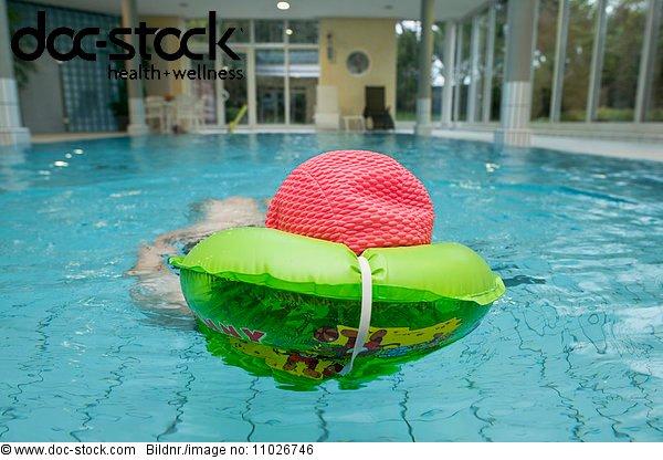 Senior in indoor swimming pool in nursing home
