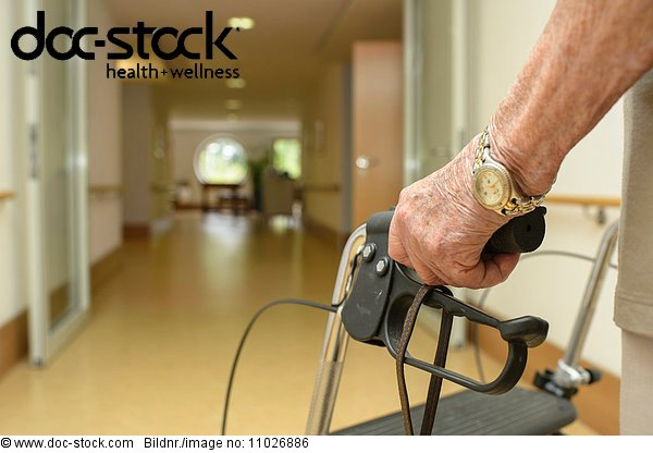 Senior with walking frame in nursing home