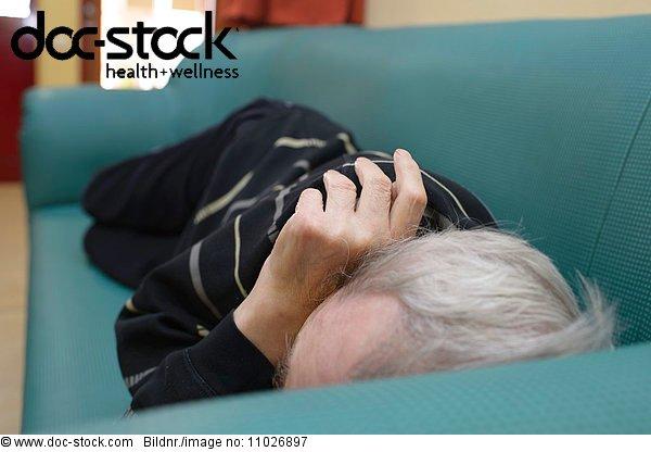 Senior sleeping in nursing home