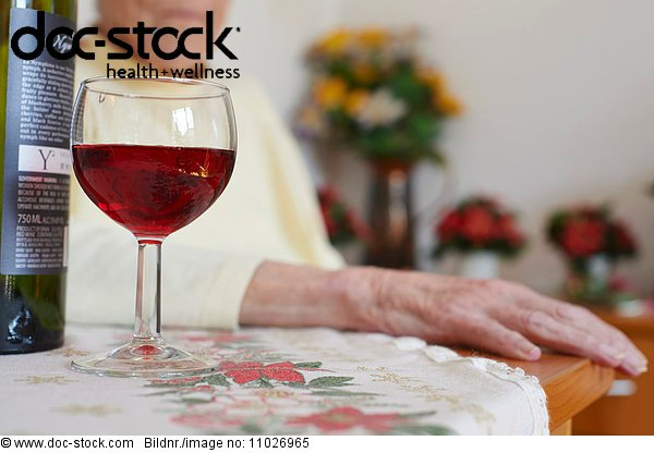 Wine bottle and glass in nursing home