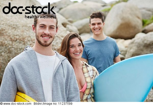 Young adults with surfboard
