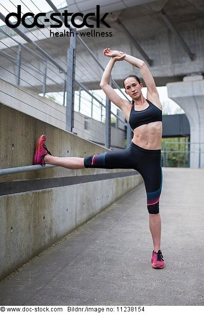 Woman stretching in sports wear