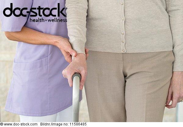 Senior woman holding support frame.